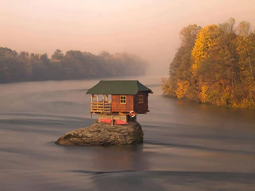This small house has been balancing on a rock and surviving through all of the weather changes for 47 years